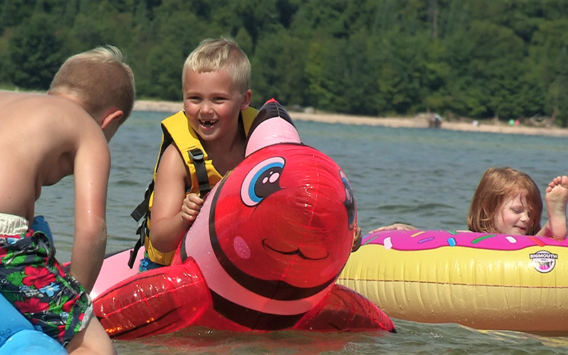 kids i the water on inner tubes and animal rafts
