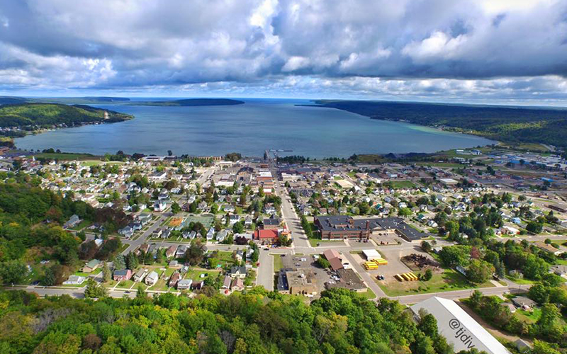 aerial view of the town with the lake in the background cloudy day