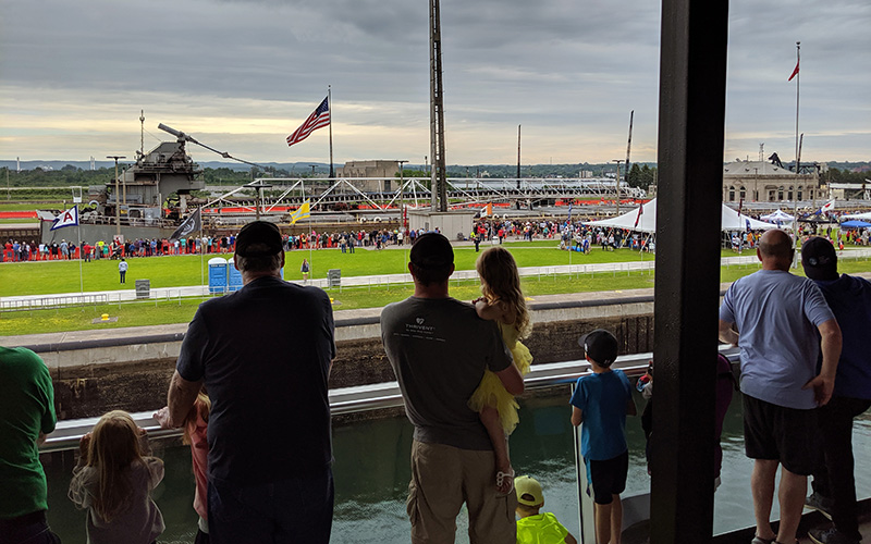families watching the freighters from inside the visitor center