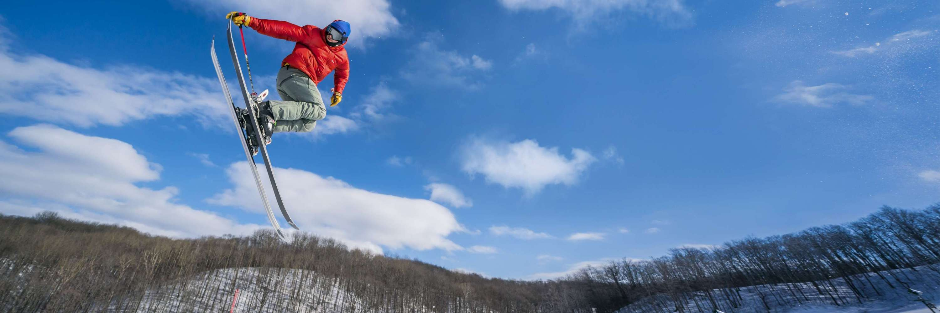 Skier in air on snowy mountain