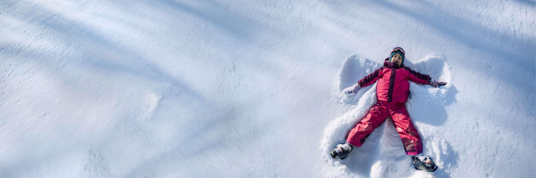 Girl making snow angle
