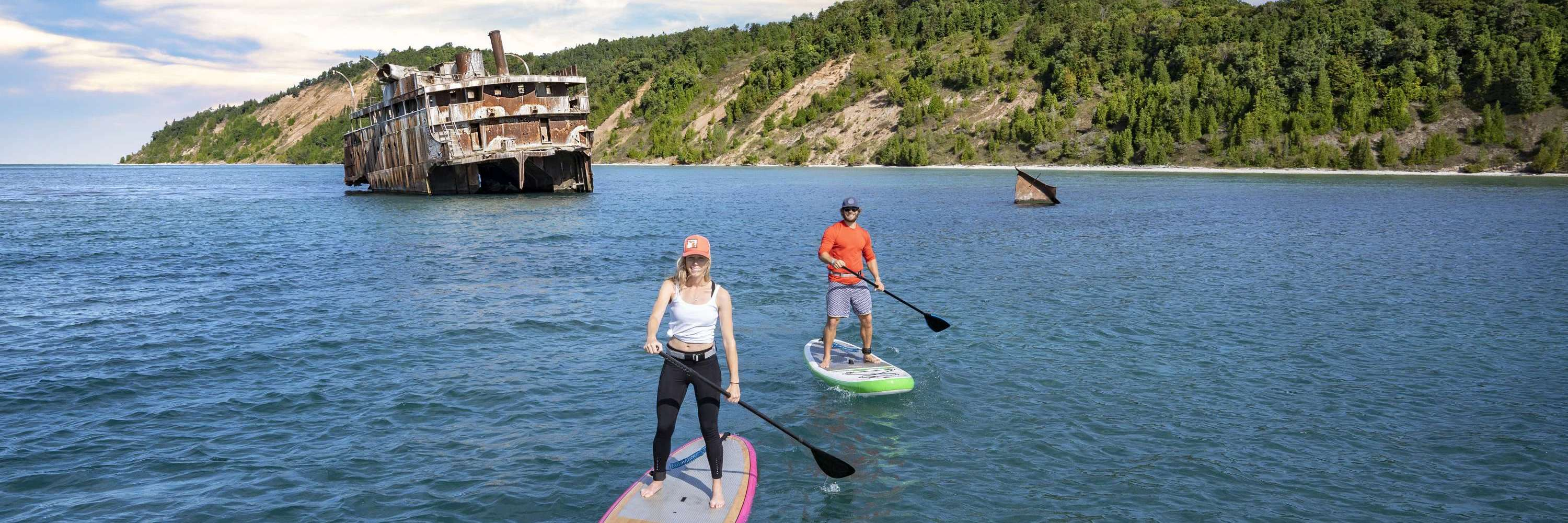 Paddle boarders by shipwreck near South Manitou Island