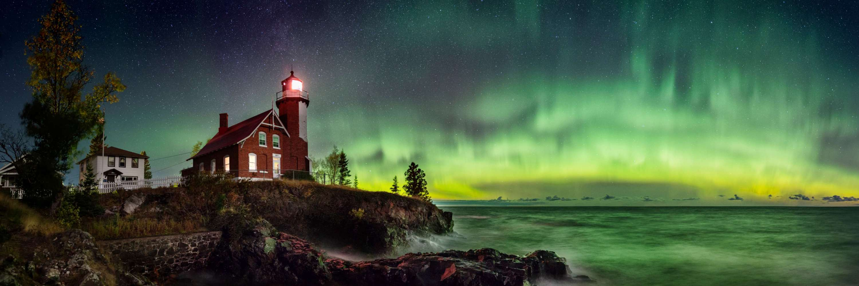 The northern lights over the Eagle Harbor Lighthouse