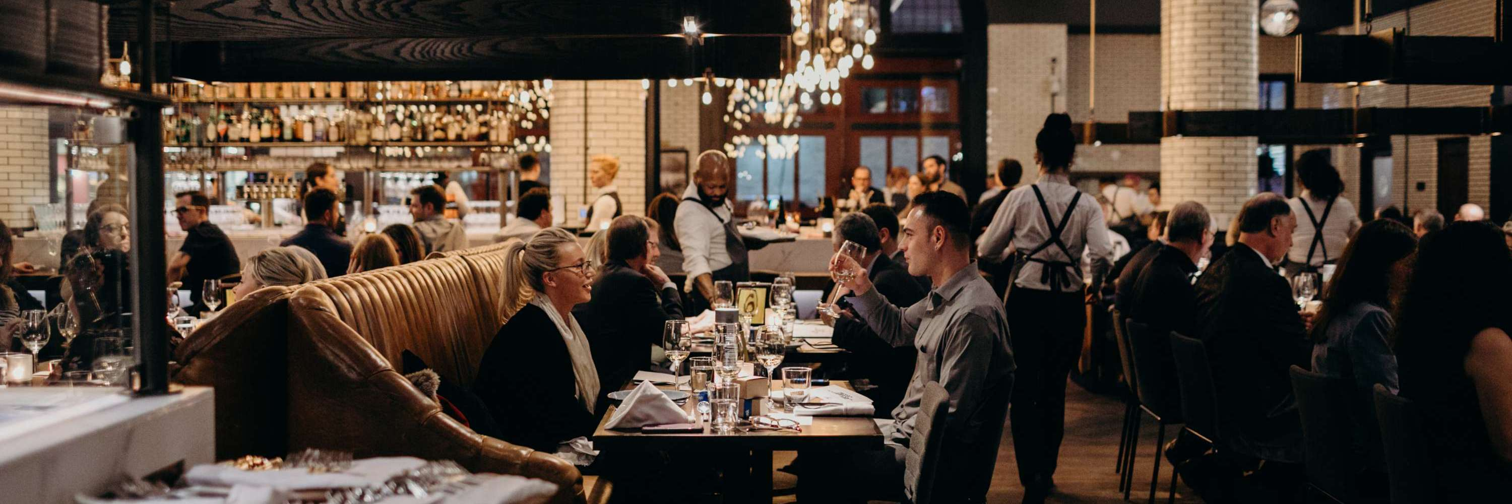 People dining at Detroit restaurant in the evening