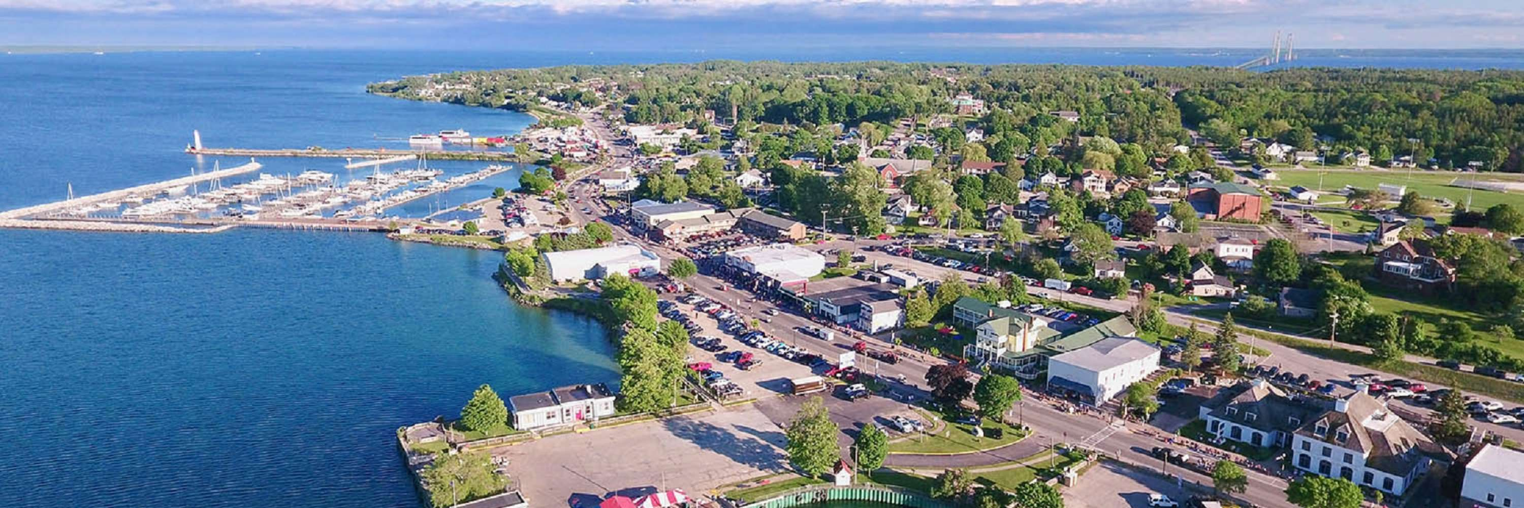 aerial view over st. ignace, ferry in the water loading to go to mackinac island