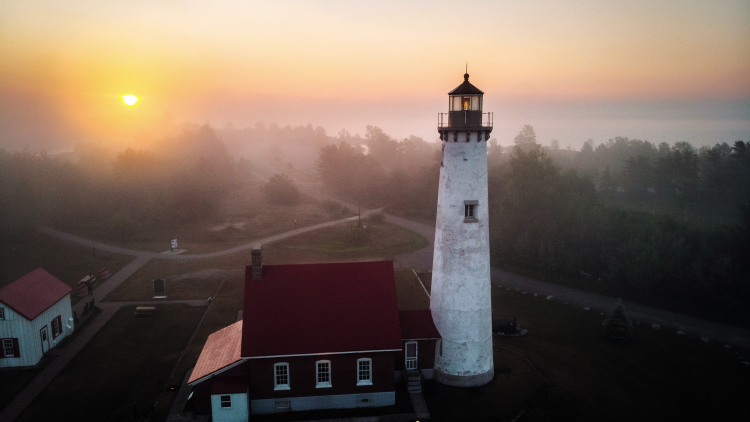 View from high above a lighthouse as the sun is rising over the lake