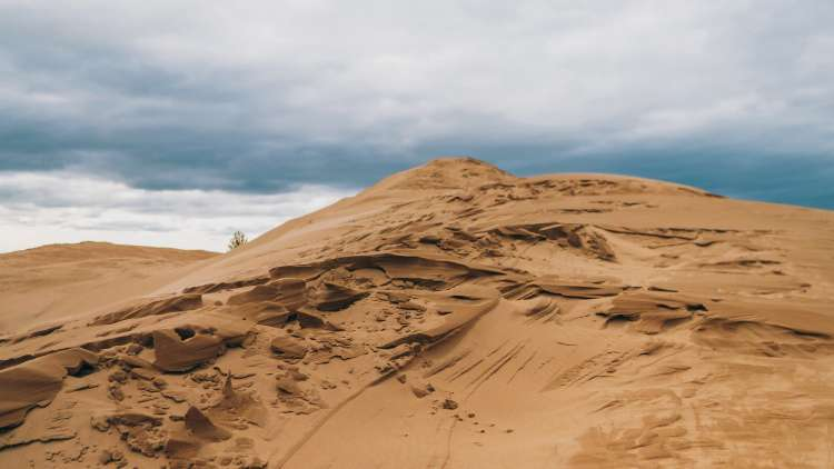 Crest of the sand dunes on a partly cloudy day