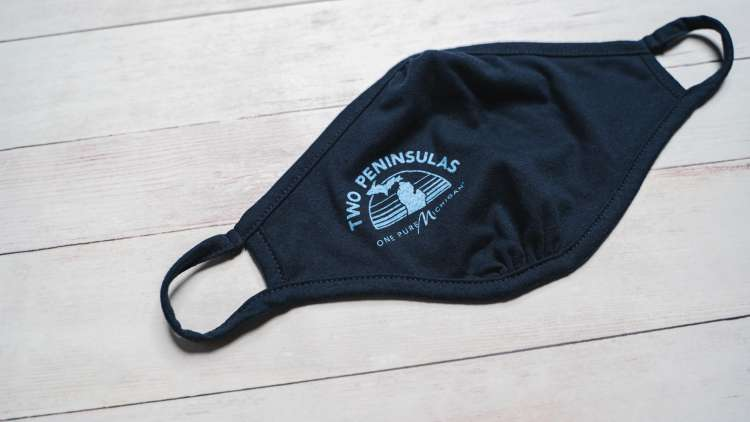 "Cloth face mask that reads ""Two Peninsulas, One Pure Michigan"""