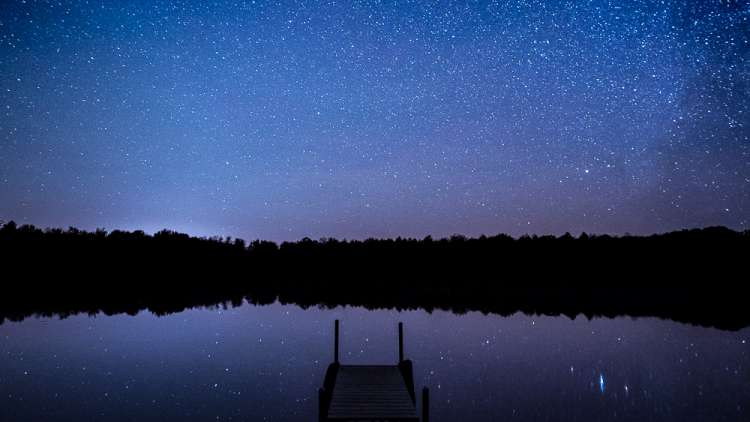 stargazing at night over the lake