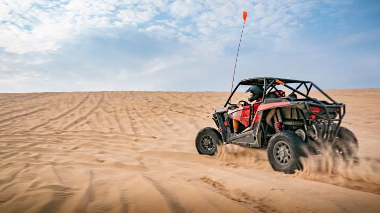 dune buggy on the sand at silver lake sand dunes
