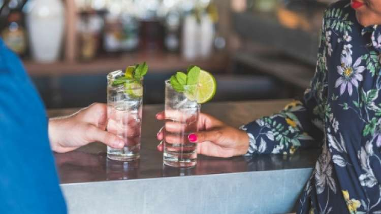 Couple drinking mix drinks at bar