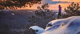 Woman snowshoeing on Sugarloaf Mountain.