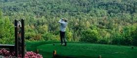 Golfer hitting ball at Treetops Resort.