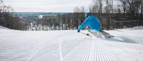 Man downhill skiing on Schuss Mountain at Shanty Creek Resorts