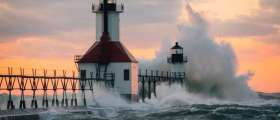 Waves crashing against the Outer Lighthouse on St. Joseph's North Pier