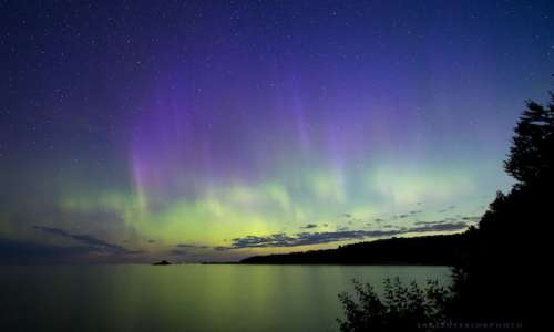 Northern lights over Great Lakes shoreline