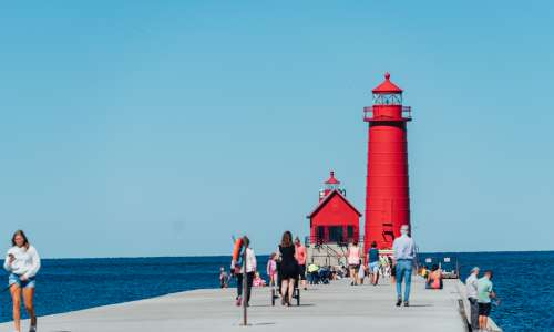 People walking to Grand Haven lighthouse