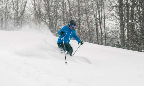 Man skiing down hill in Otsego