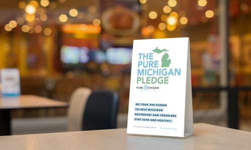 Tent card with Pure Michigan Pledge information