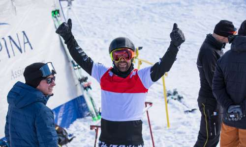 Nick Baumgartner celebrates after snowboarding