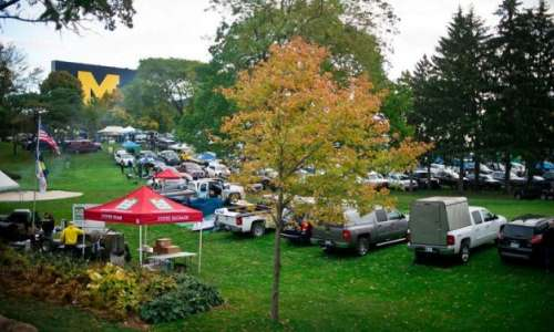Cars tailgating near the University of Michigan football stadium