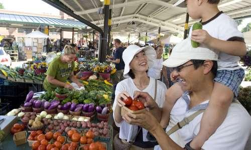 Family enjoying the Ann Arbor Farmer's Market