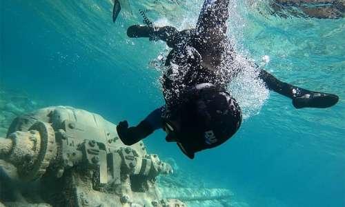 Scuba diver examining shipwreck underwater