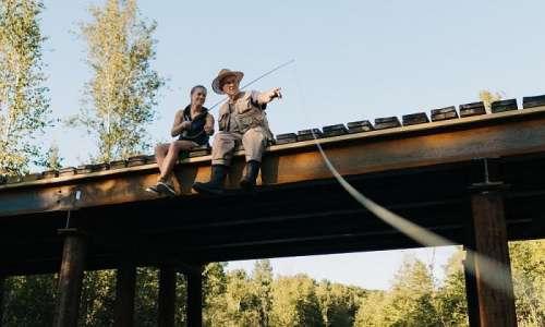 Fishing on a Bridge at Boardman River in Traverse City