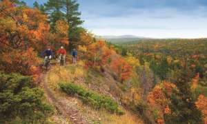 Mountain bikers in Copper Harbor during fall