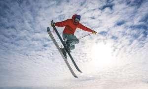 Skier jumping in air.