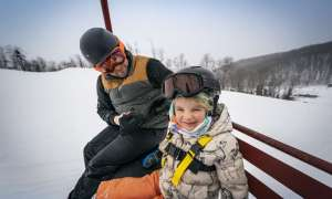 Father and daughter on ski lift