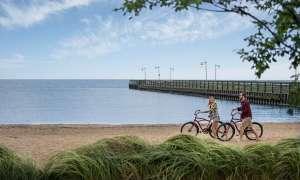 Couple with bikes on Lake Huron shoreline