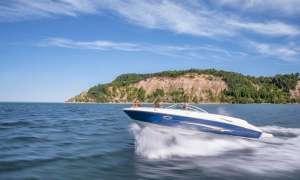 Power boat by island