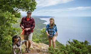 Couple and dog hiking Bare Bluff Trail