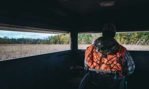 Man sitting in deer blind