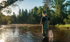 Woman fly fishing on a river