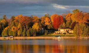 Lake with fall trees in Charlevoix