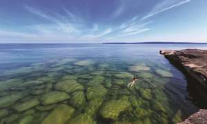 Woman swimming in Lake Superior