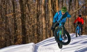 Fat tire bikers in snowy forest