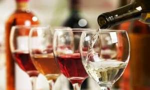 pouring wine in wine glasses