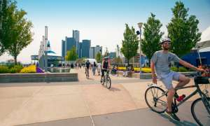 several people on bike at rivard plaza in detroit