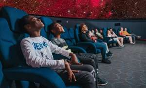 row of students in the planetarium looking at the screen