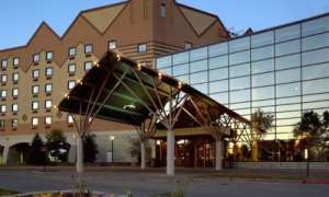 exterior view of hotel and casino, glass windows, brown peak roof