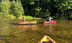 kayakers on the river in manistee