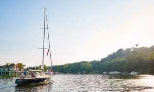 sailboat in the lake on sunny day
