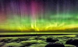 northern lights of purple green and yellow with stars