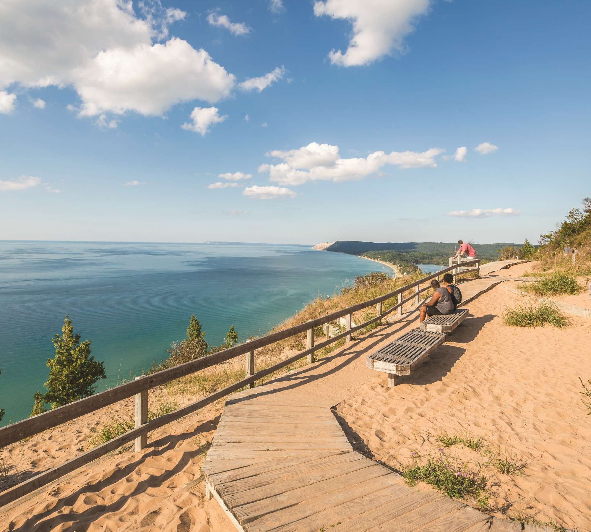 Traverse City Coastline with visitors on benches
