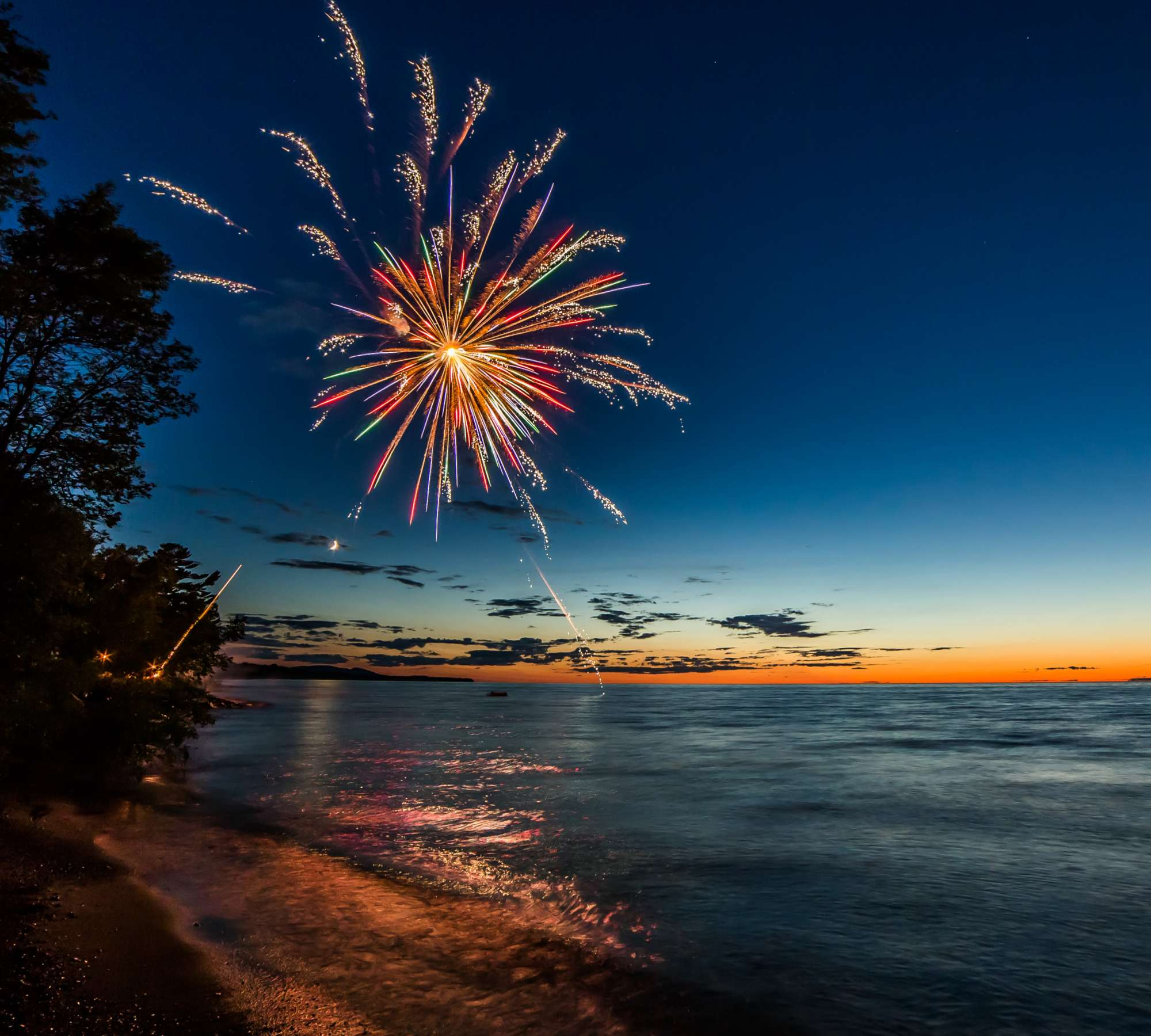A firework over water in the Upper Peninsula