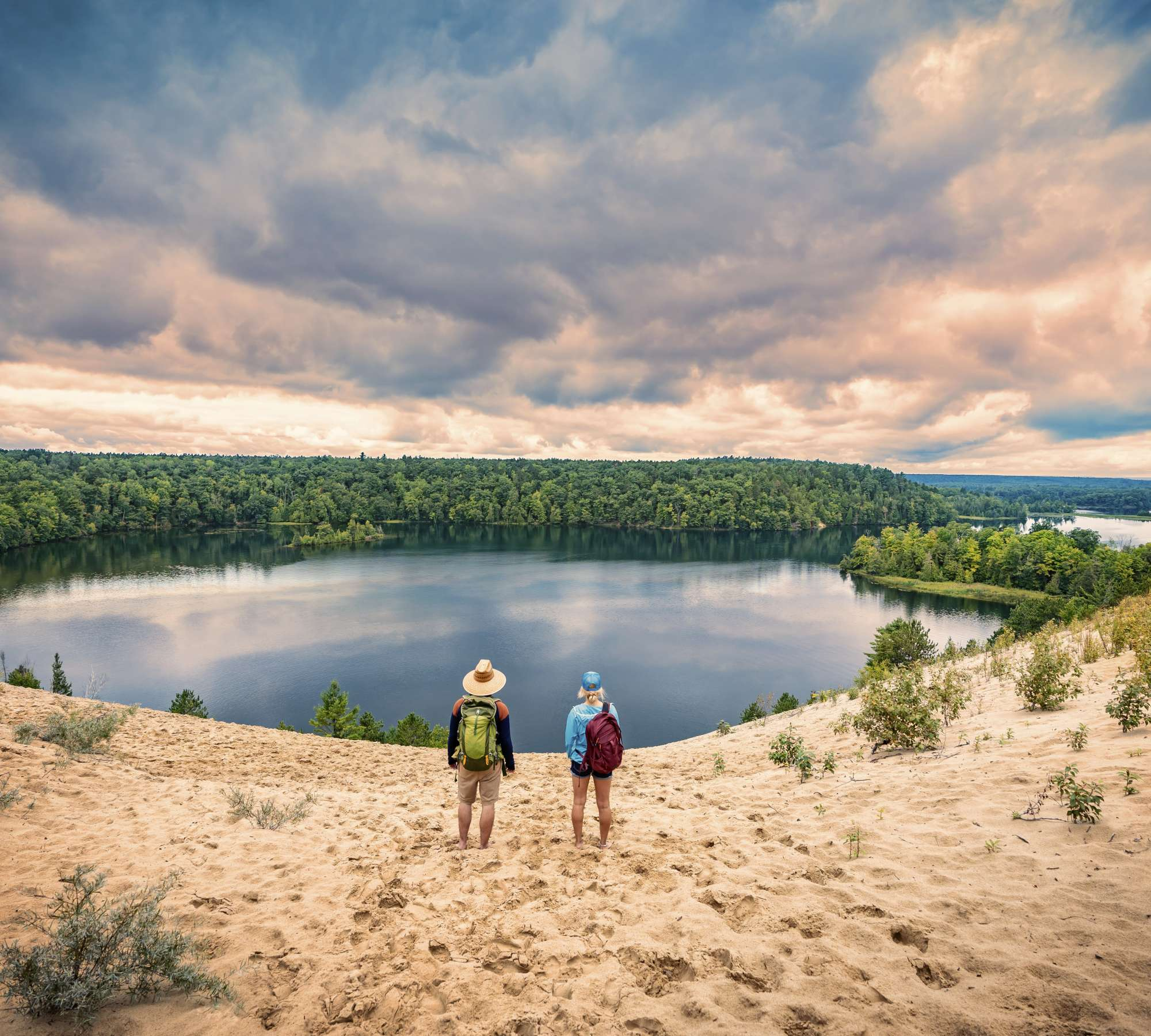 Hikers standing atop the Au Sable River Dunes