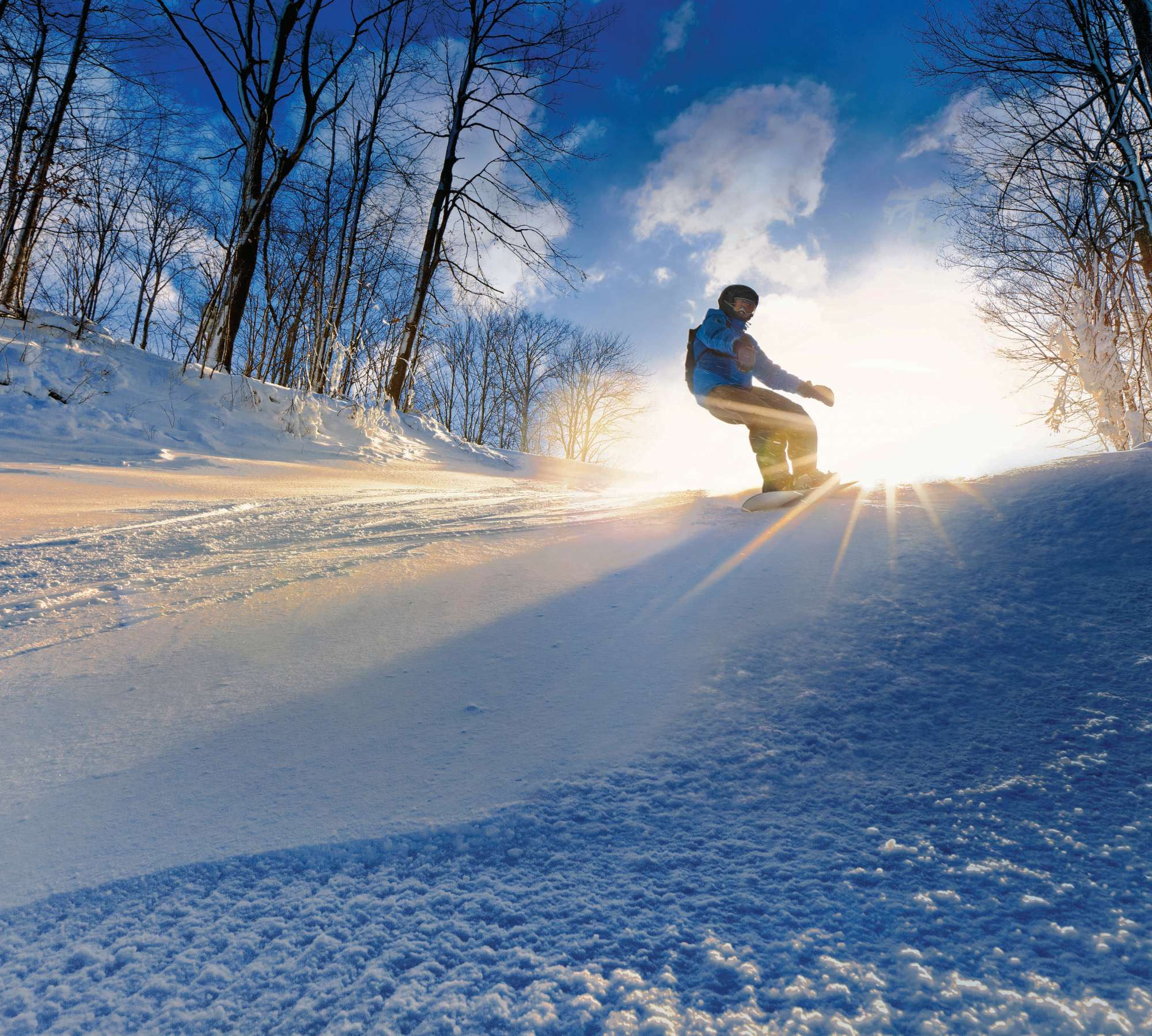 Snowboarder on fresh-groomed snow